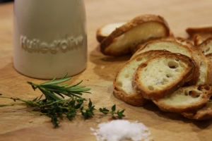Thinly sliced bread, salt flakes, some rosemary, thyme and olive oil